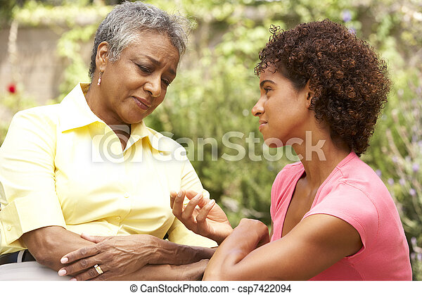 Senior Woman Being Consoled By Adult Daughter - csp7422094