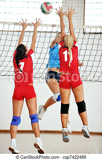 girls playing volleyball indoor game - csp7422489