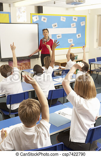 Schoolchildren Studying In Classroom With Teacher - csp7422790
