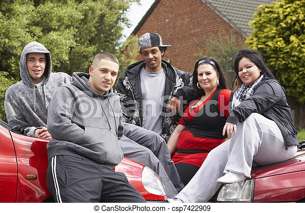 Gang Of Youths Sitting On Cars - csp7422909