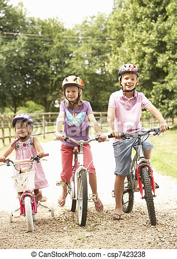 Children In Countryside Wearing Safety Helmets - csp7423238