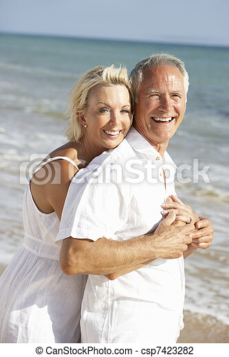 Senior Couple Enjoying Beach Holiday - csp7423282