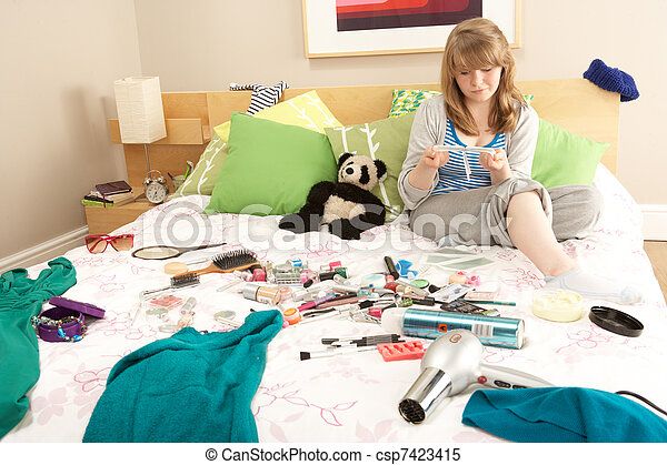 Teenage Girl In Untidy Bedroom Waxing Legs - csp7423415