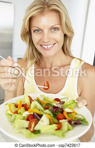 Mid Adult Woman Eating A Healthy Salad - csp7423617