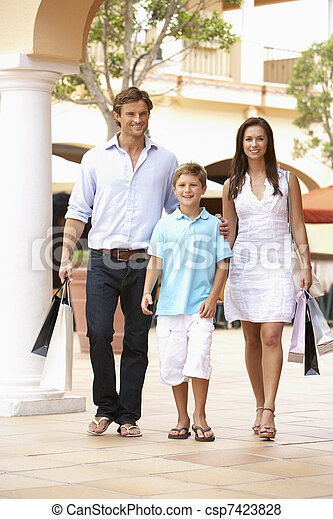 Young Family Enjoying Shopping Trip Together - csp7423828