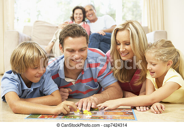 Family Playing Board Game At Home With Grandparents Watching - csp7424314