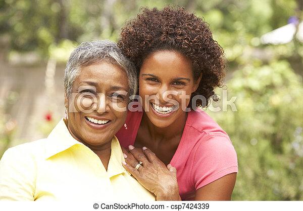 Senior Woman Hugging Adult Daughter - csp7424339