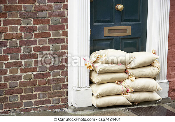 Sandbags Stacked In A Doorway In Preparation For Flooding - csp7424401