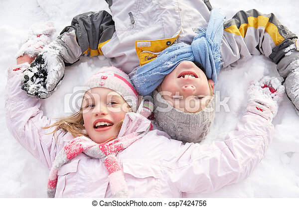 Children Laying On Ground Making Snow Angel - csp7424756