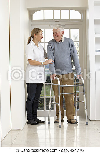 Carer Helping Elderly Senior Man Using Walking Frame - csp7424776