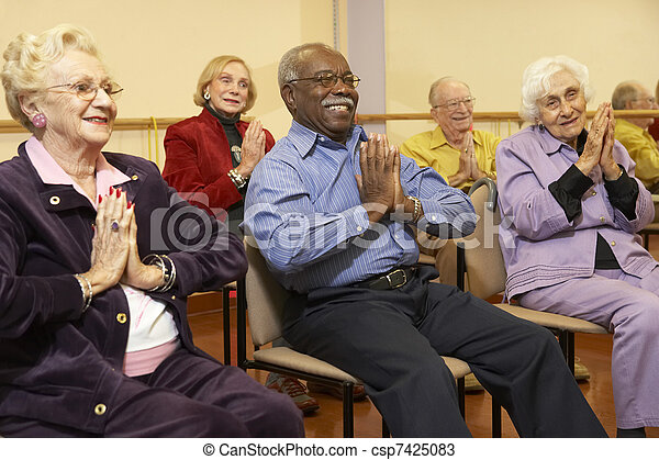 Senior adults in a stretching class - csp7425083