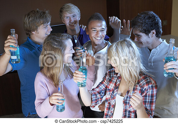 Group Of Teenage Friends Dancing And Drinking Alcohol - csp7425225