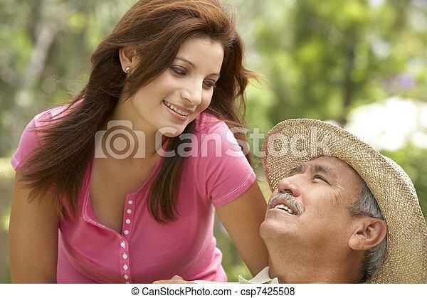 Senior Man With Adult Daughter In Garden - csp7425508