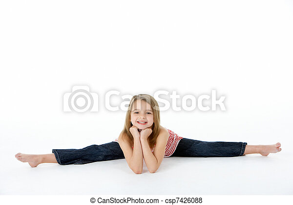 Young Girl In Gymnastic Pose Doing Splits - csp7426088