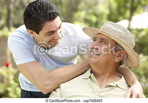 Senior Man With Adult Son In Garden - csp7426403