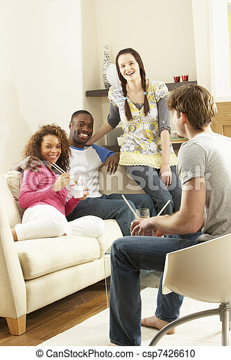 Group Of  Friends Enjoying Chinese Takeaway Meal At Home - csp7426610
