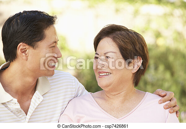 Senior Woman With Adult Son In Garden - csp7426861