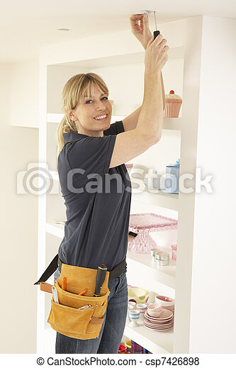 Female Electrician Installing Light Fitting In Home - csp7426898