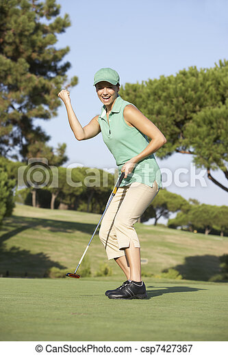 Female Golfer On Golf Course Putting On Green - csp7427367