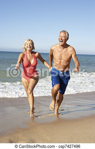 Senior Couple Enjoying Beach Holiday - csp7427496