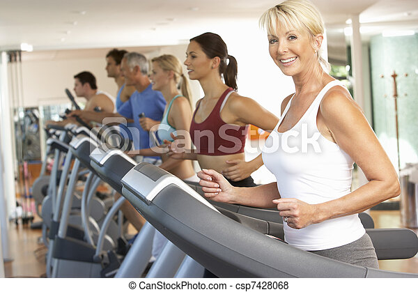 Senior Woman On Running Machine In Gym - csp7428068