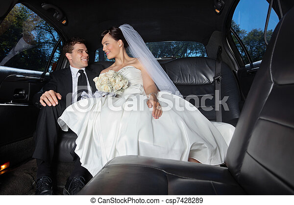 Bride and Groom in Limo - csp7428289
