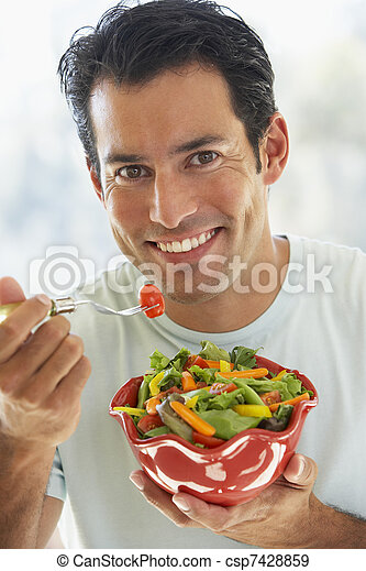 Mid Adult Man Eating Salad - csp7428859