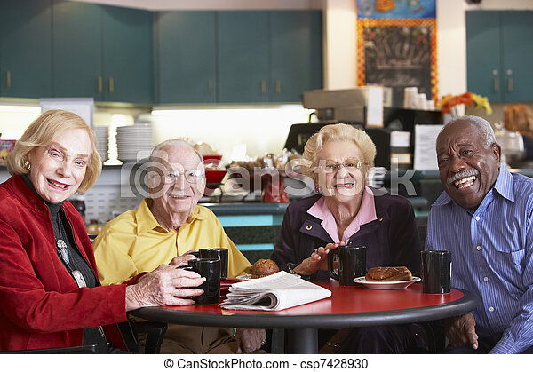 Senior adults having morning tea together - csp7428930