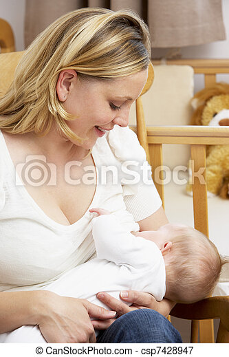 Mother Breastfeeding Baby In Nursery - csp7428947