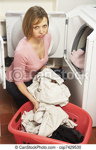 Unhappy Woman Doing Laundry - csp7429530