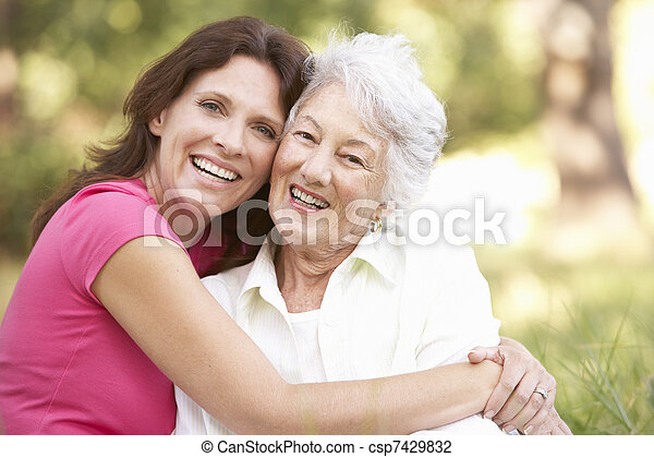 Senior Woman With Adult Daughter In Park - csp7429832