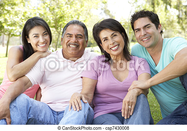Grandparents With Adult Children In Park - csp7430008