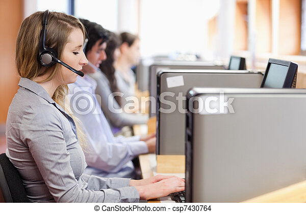 Operators using a computer in call center - csp7430764