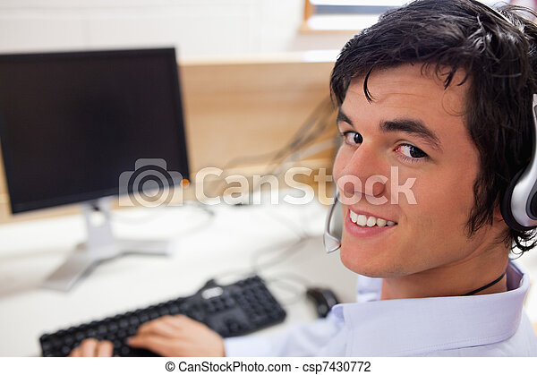 Young operator using a computer - csp7430772