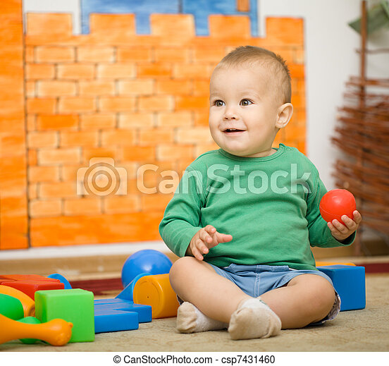 Little boy is playing with toys in preschool - csp7431460