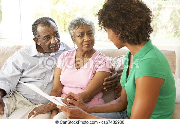 Senior Couple Talking To Financial Advisor At Home - csp7432930