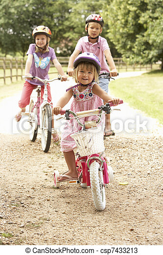 Children In Countryside Wearing Safety Helmets - csp7433213