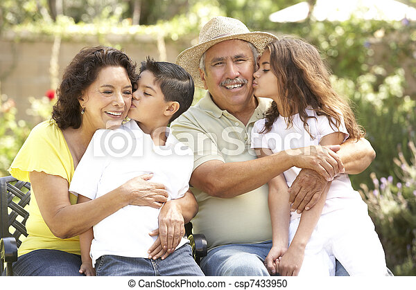 Portrait Of Grandparents With Grandchildren In Park - csp7433950