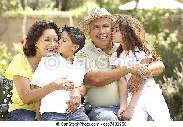 Portrait Of Grandparents With Grandchildren In Park - csp7433950