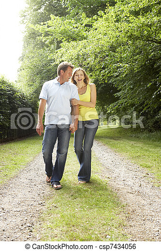 Middle aged couple walking in countryside - csp7434056
