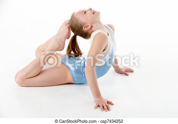 Studio Portrait Of Young Female Gymnast - csp7434252