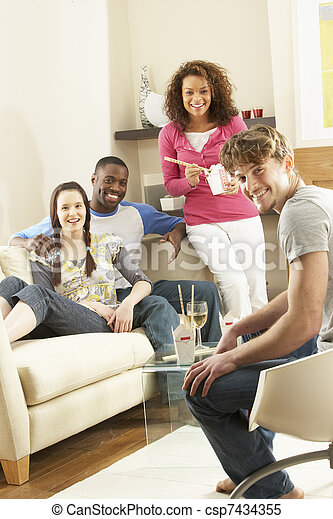 Group Of  Friends Enjoying Chinese Takeaway Meal At Home - csp7434355