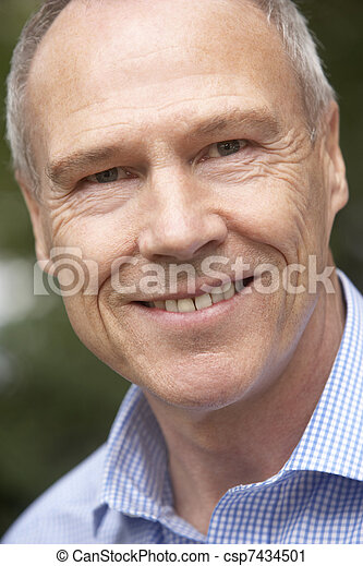 Portrait Of Middle Aged Man Smiling At The Camera - csp7434501