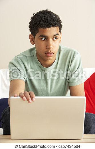 Worried Looking Boy Using Laptop - csp7434504