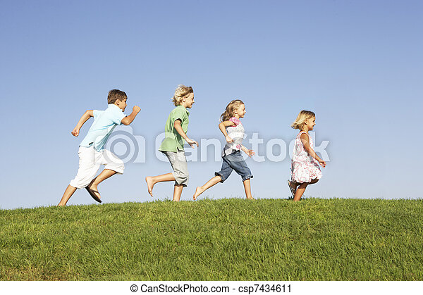 Young children running through field - csp7434611