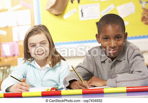 Schoolchildren Studying in classroom - csp7434932
