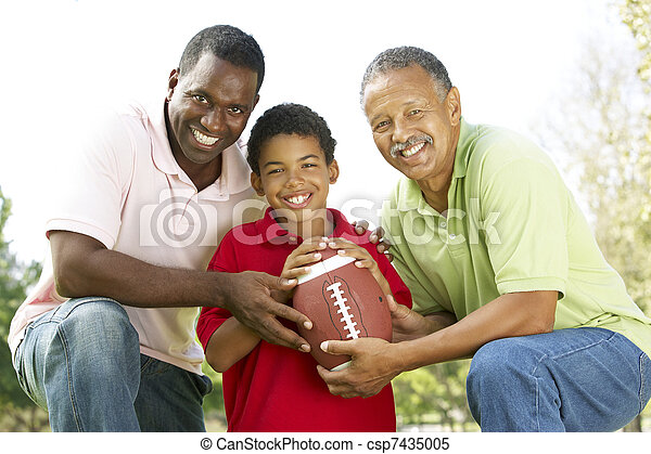 Grandfather With Son And Grandson In Park With American Football - csp7435005