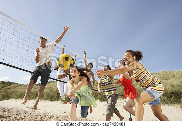 Group Of Teenage Friends Playing Volleyball On Beach - csp7435481
