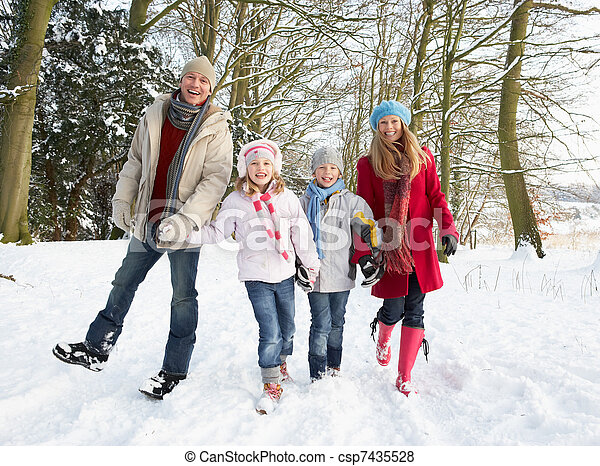 Family Walking Through Snowy Woodland - csp7435528