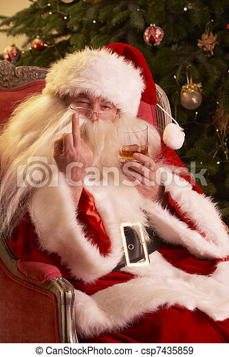 Santa Claus Making Rude Gesture To Camera In Front Of Christmas Tree - csp7435859